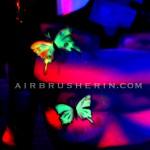 Bodypainting zum Thema Illusion mit Neoneffekt